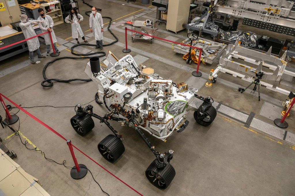 Engineers test drive the Earth-bound twin of NASA's Perseverance Mars rover for the first time in a warehouselike assembly room at the agency's Jet Propulsion Laboratory in Southern California.
