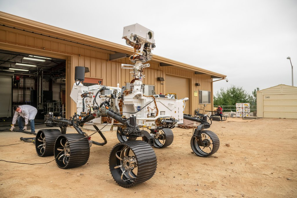 The full-scale engineering model of NASA's Perseverance rover has put some dirt on its wheels at NASA's Jet Propulsion Laboratory in Southern California.