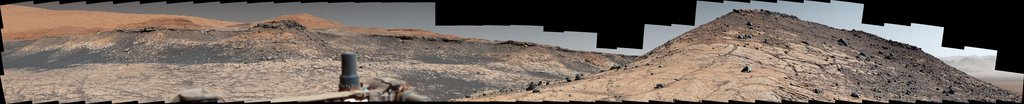 This wide panorama was taken by NASA's Curiosity Mars rover on Dec. 19, 2019. On the righthand foreground is Western Butte. The ridge with a crusty cap in the background is the Greenheugh pediment.