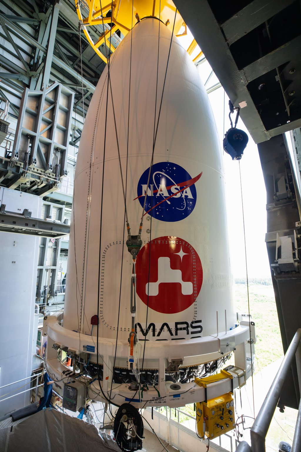 The nose cone containing NASA's Mars 2020 Perseverance rover is maneuvered into place atop its Atlas V rocket. The image was taken at Cape Canaveral Air Force Station in Florida on July 7, 2020.