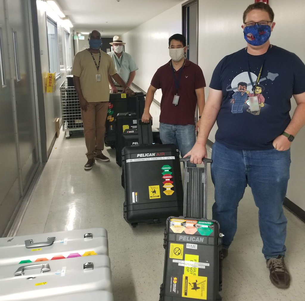 JPL engineers and technicians follow COVID-19 Safe-at-Work guidelines as they transport the RIME transmitter and electronics on Aug. 19, 2020, for shipping to the Italian Space Agency (ASI).