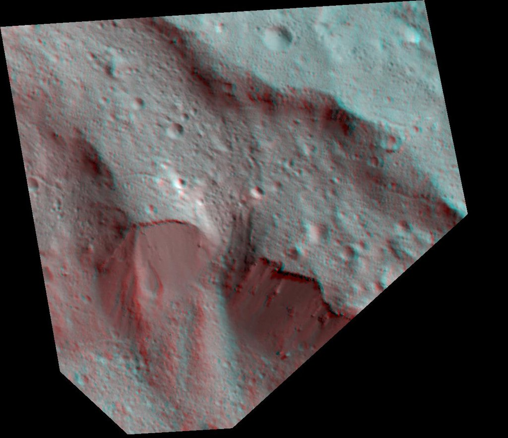 This Dawn stereo anaglyph of Occator Crater on Ceres shows impact melt deposits draped on faulted blocks on the northeastern rim of the 57-mile (92-kilometer) diameter crater.
