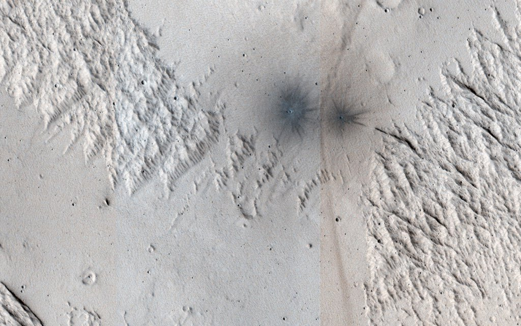 This image acquired on June 23, 2020 by NASA's Mars Reconnaissance Orbiter, shows terrain near Mangala Valles.