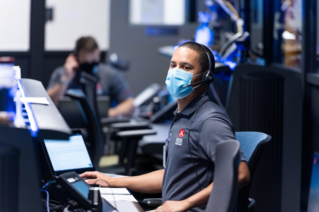 Matt Smith, flight director for the second Mars 2020 mission trajectory correction maneuver (TCM-2), studying the screens at NASA's Jet Propulsion Laboratory in Southern California.