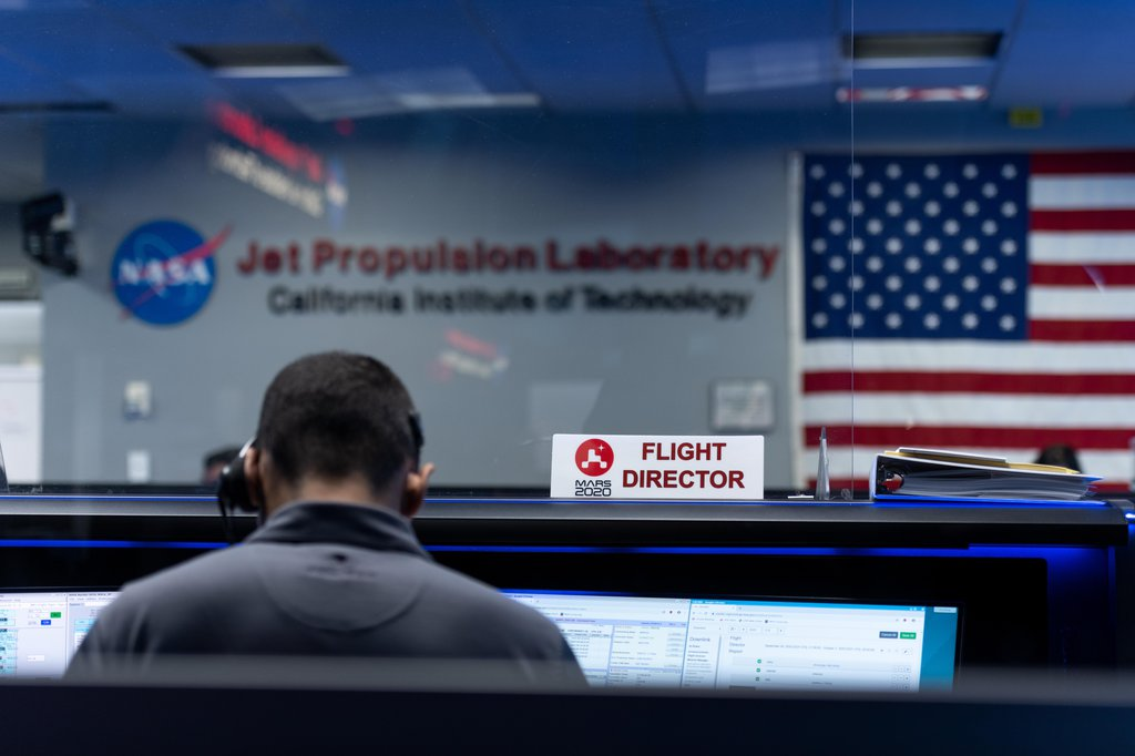 Flight Director Matt Smith studies the data during the second post-launch trajectory correction maneuver during Perseverance's cruise to Mars.