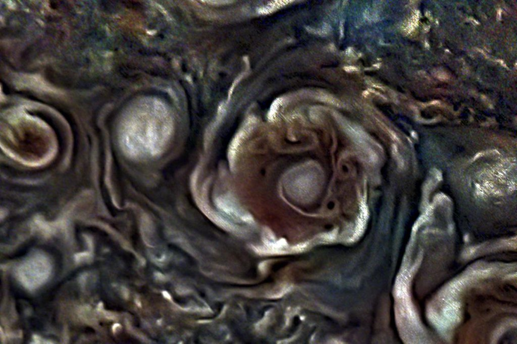 This JunoCam image from NASA's Juno mission depicts one of the eight circumpolar cyclones that surround a central cyclone at the gas giant's north pole.