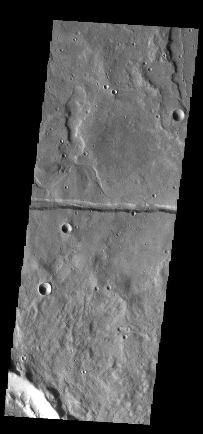 This image from NASA's Mars Odyssey shows a linear depression, part of Sirenum Fossae.