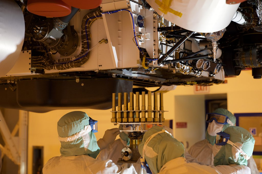 A tray holding 39 sample tubes, each protected in a gold-colored sheath, is installed in NASA's Perseverance rover in this picture taken at the agency's Kennedy Space Center on May 21, 2020.