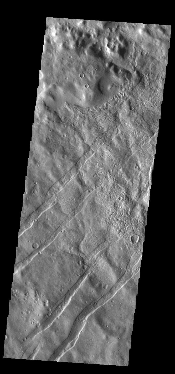 This image from NASA's Mars Odyssey shows linear depressions known as tectonic graben.
