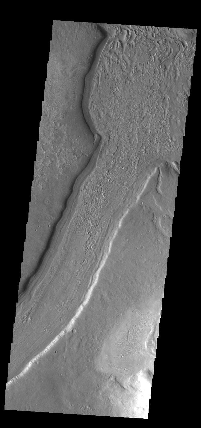 This image from NASA's Mars Odyssey shows a short section of Reull Vallis. Reull Vallis starts in Promethei Terra and empties into Hellas Plainitia.