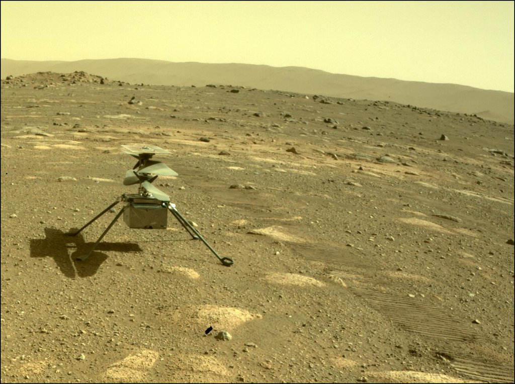 NASA's Ingenuity helicopter can be seen on Mars as viewed by the Perseverance rover's rear Hazard Camera on April 4, 2021, the 44th Martian day, or sol of the mission.