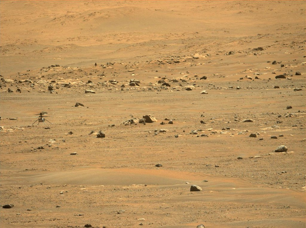 NASA's Ingenuity Mars Helicopter's was captured after landing on May 7, 2021, by the Mastcam-Z imager aboard the agency's Perseverance rover. This was the helicopter's fifth flight, and the first time the helicopter flew to a new landing site.